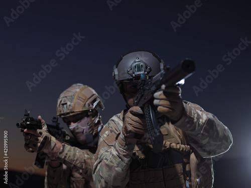 Fototapeta soldiers squad in night mission