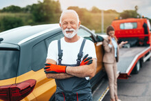 Handsome Senior Man Working In Towing Service On The Road. Roadside Assistance Concept.