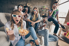 Portrait Of Attractive Amazed Cheerful Friends Gathering Watching Movie Having Fun Pastime In House Loft Brick Style Interior Indoors