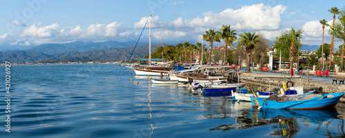 Fototapeta The promenade of the city of Fethiye, boats are at bay in the blue waters of the Mediterranean. The resort town of Turkey. obraz