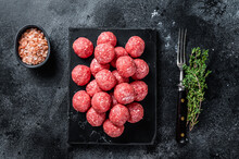 Raw Meatballs From Minced Beef And Pork Meat With Thyme. Wooden Background. Top View