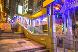 Fototapeta Uliczki - Hong Kong, China - December 10, 2016: the Central-Mid-Levels escalator, the longest outdoor covered escalator system in the world, Central Hong Kong, by night.