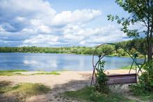 Old Swings On Sandy Lake Bank In Summer Day Landscape