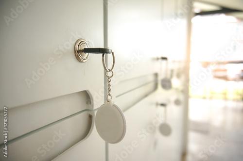Fototapeta Key in keyhole on locker door. Keys stuck in a lock