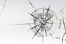 Cracks On The Glass On A White Background.
