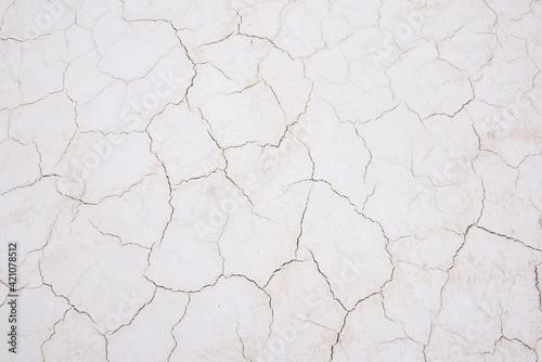 Tableau sur Toile Damaged sandy white surface texture with cracks
