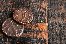 Two Small Copper Coins Or Widows Mites On A Rustic Wooden Table