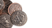 Pile Of Ancient Roman Coin Replicas  Isolated On A White Background