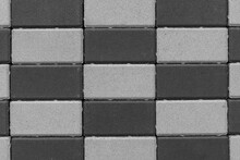The Wall Is Made Of Dark And Light Bricks. Color - Charcoal, Dark Gray.
