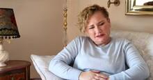 Woman Having Abdominal Pain 1