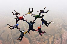 Skydivers Holding Hands Making A Fomation. High Angle View.