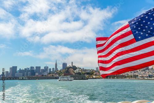 San Francisco, California, United States - August 14, 2016: american flag in San Francisco Bay cityscape Wallpaper Mural