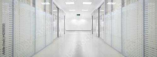 Obraz na plátně Empty bank office corridor with glass walls and doors