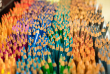 Rows Of Colored Pencils Standing Upright In An Art Store Display With A Blue Pencil Standing Out Among The Others