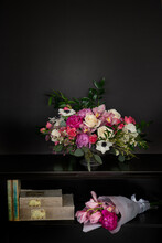 Pink, White, And Purple Flower Bouquet On The Book Shelf.