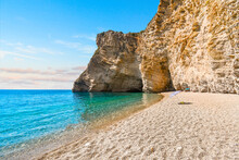 The Cliffs And Sandy Shoreline Of Paradise Beach, Also Known As Chomi Beach In The Aegean Sea Off Corfu, Greece.