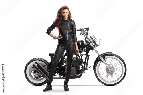 Fotografering Full length portrait woman with a chopper motorbike posing