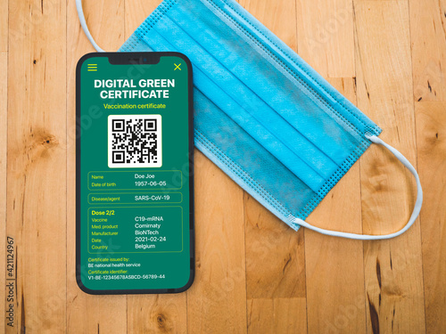 Fototapeta Digital green certificate - European vaccination certificate with QR Code on a mobile phone allowing movement and travel in Europe - coronavirus Covid 19 - France obraz