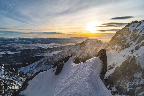 Obraz Sunset in winter alpine like mountain landscape of High Tatras, Slovakia. Snow covered mountains, high rocky faces and peaks during sunset. - fototapety do salonu