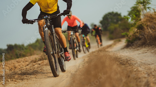 Fotografiet Group of Asian cyclists, they cycle through rural and forest roads