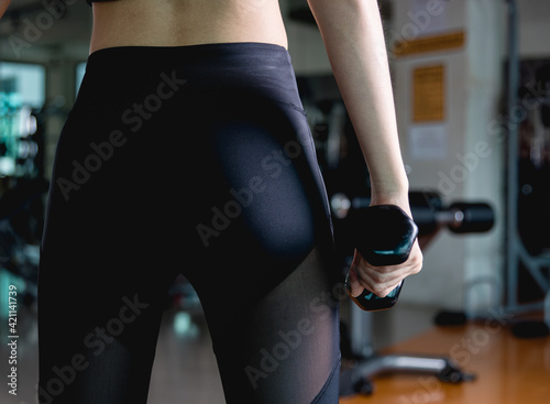 Fototapeta Sexy young back woman beautiful ass in thong at fitness gym