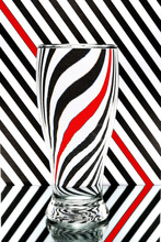 Refraction Of Light By A Wine Glass On A Black And White Striped Background. Abstract Glass Art.
