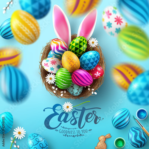Obraz Easter Poster And Flyer Template with Easter eggs in the nest and Rabbit ears on bule background.Greetings and presents for Easter Day in flat lay styling.Promotion and shopping template for Easter - fototapety do salonu