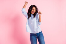 Photo Of Crazy Excited Lady Dance Raise Hands Open Mouth Close Eyes Wear Blue Sweater Jeans Isolated Pink Background