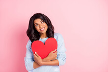 Photo Of Dreamy Inspired Lady Cuddle Red Paper Heart Look Empty Space Wear Blue Sweater Isolated Pink Background