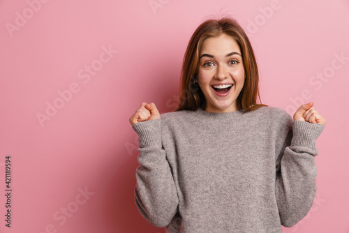 Fotografie, Obraz Ginger young excited woman smiling while making winner gesture