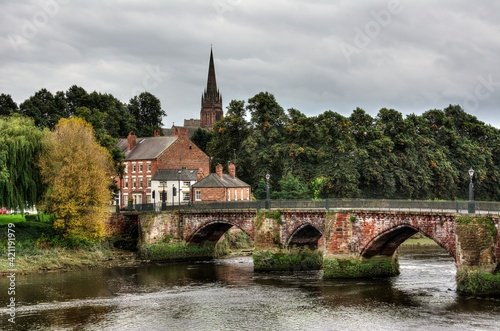 Fototapeta A stone bridge over river Dee in Chester England