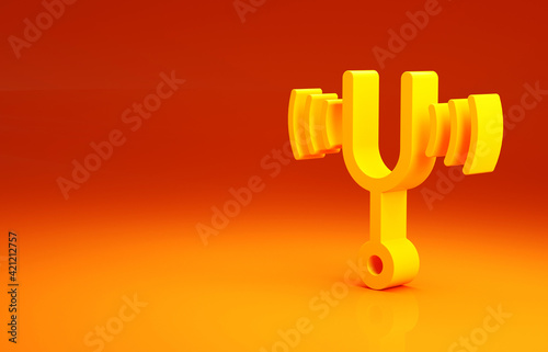 Tableau sur Toile Yellow Musical tuning fork for tuning musical instruments icon isolated on orange background