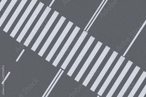 Fotografiet White pedestrian crossing on empty city street, top view