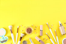 Flat Lay Composition With Makeup Brushes On Yellow Background, Space For Text