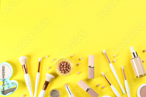 Fototapeta Flat lay composition with makeup brushes on yellow background, space for text obraz