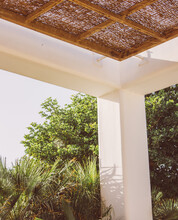 Relaxation Canopy With A Thatched Roof For Sun Protection.