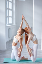 Slender And Flexible Women In White Sportswear Keep Balance And Stretching, Sport Concept