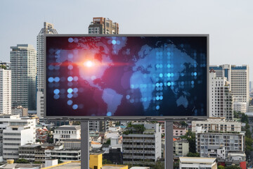 World planet Earth map hologram on billboard over panorama city view of Bangkok. The concept of international connections and business in Southeast Asia.