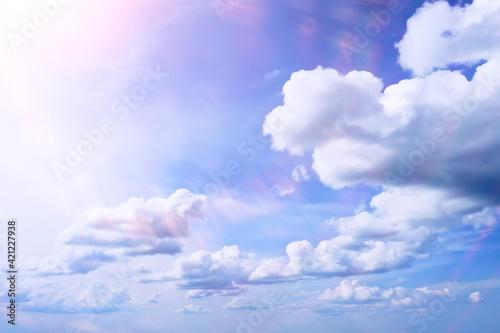 Fototapeta white clouds on blue sky background, abstract seasonal wallpaper, sunny day atmosphere obraz