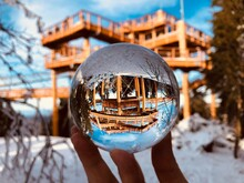 Close-up Of Hand Holding Crystal Ball In Winter