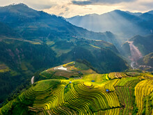 Aerial View Of Terraced Fields And Mountains Against Sky During Sunset