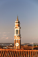 Clock Tower Amidst Buildings Against Sky In City Of Venice