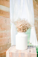 Close-up Of White Flower Vase On Table At Wooden Table