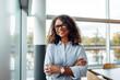 Leinwandbild Motiv Smiling businesswoman standing in office