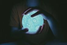 Close-up Of Hand Holding Moon Light