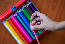 A Girl Getting Ready For A New School Season With Her Sharpened Multi Coloured Pencil