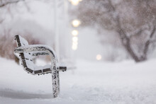 Close-up Of Park Bench During Winter