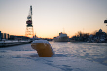 Selective Focus On Yellow Mooring Bollard At Winter With Boats In The Background