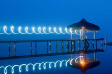 Illuminated Light Against Blue Sky At Night