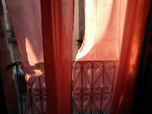 Close-up Of Orange Door Of Building Balcony Old City Sardinia